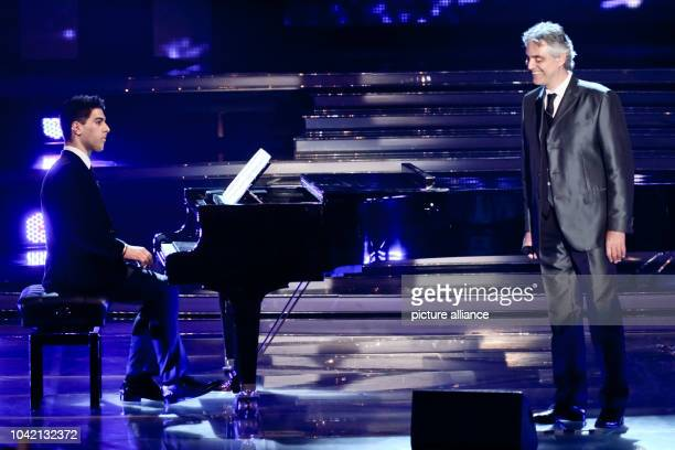 Singer Andrea Bocelli performs with his son Amos Bocelli during the TV show 'Welcome to Carmen Nebel' at Messehalle in Erfurt Germany 13 April 2013...