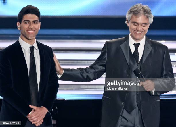 Singer Andrea Bocelli stands next to his son Amos Bocelli during the television show 'Welcome to Carmen Nebel' at the trade fair halls in Erfurt...