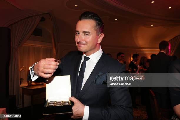 Singer Andreas Gabalier eats a 'Silvia Schneider praline' during the presentation of the collection 'Dressing Gown' and perfume of fashion designer...