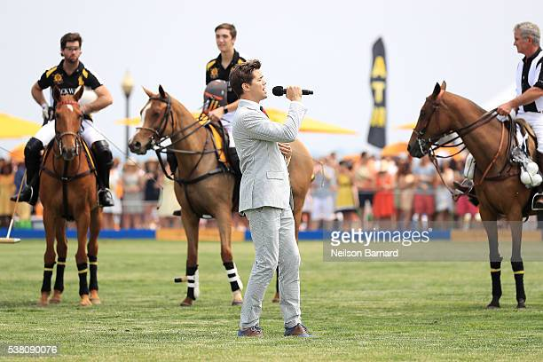 Singer Andrew Rannells sings the national anthem at the Ninth Annual Veuve Clicquot Polo Classic at Liberty State Park on June 4 2016 in Jersey City...