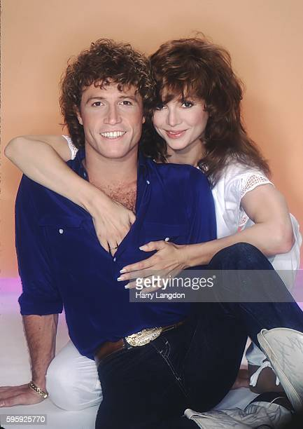 Singer Andy Gibb and girlfriend actress Victoria Principal pose for a portrait in 1981 in Los Angeles California