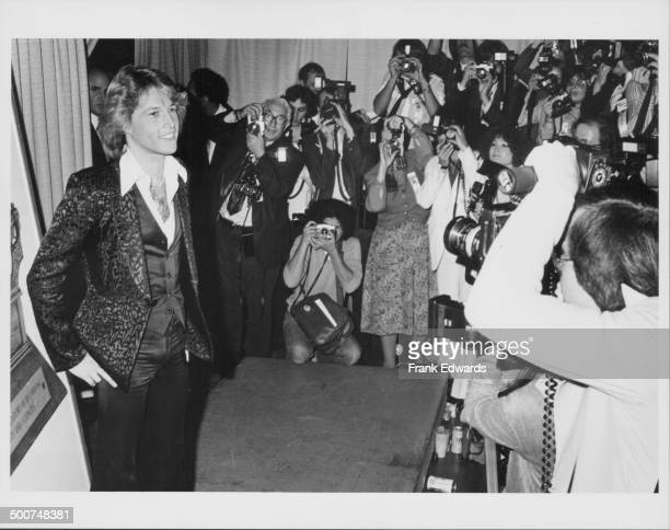 Singer Andy Gibb being photographed by the press as he attends the 21st Grammy Awards Shrine Auditorium California February 15th 1979