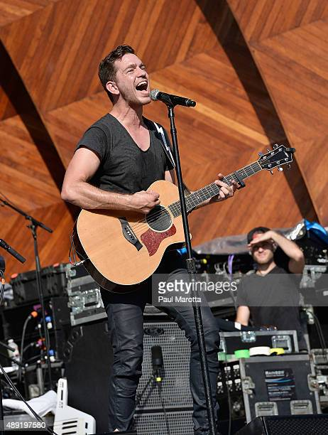 Singer Andy Grammer performs at MixFest 2015 at the Hatch Shell on September 19 2015 in Boston Massachusetts
