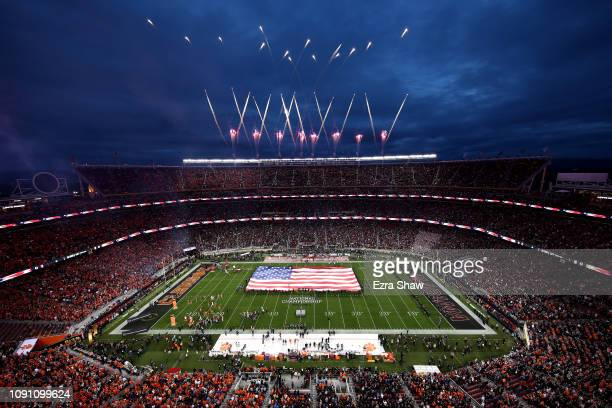 Singer Andy Grammer performs the national anthem as the American flag waves on the field prior to the College Football Playoff National Championship...