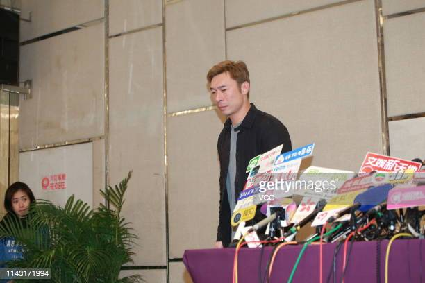 Singer Andy Hui Chion attends a press conference as he admits to having an extramarital affair on April 16 2019 in Hong Kong China