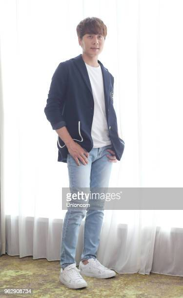 Singer Andy Lee Sunho of South Korean boy group Shinhwa poses for photos during an interview on May 26 2018 in Taipei Taiwan of China