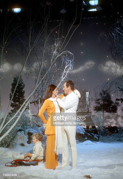 Singer Andy Williams and wife Claudine Longet perform on a Christmas show circa 1970