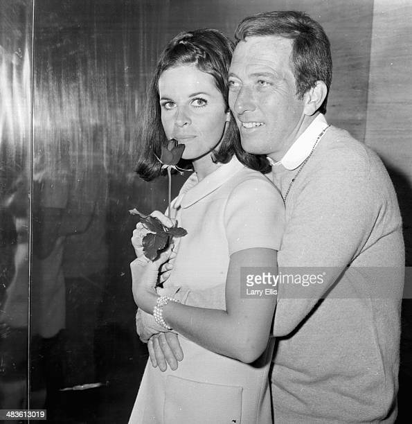 Singer Andy Williams holding a rose for his wife Claudine Longet at a press conference 16th May 1968