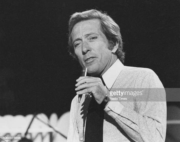 Singer Andy Williams pictured performing on the television chat show 'Parkinson' July 15th 1972