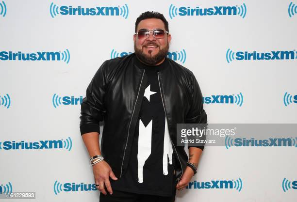 Singer Angel Lopez poses for photos after performing with Tony Succar during a taping for SiriusXM's Caliente Channel at the SiriusXM studios in New...