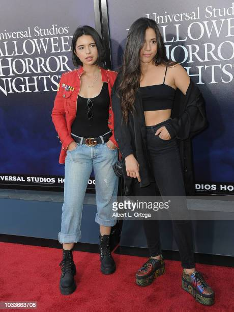 Singer Angela Aguilar and sister arrive for Universal Studios Hollywood's Opening Night Celebration Of 'Halloween Horror Nights' held at Universal...