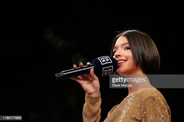 Singer Angela Aguilar performs the Mexican national anthem before the WBO light heavyweight title fight between Canelo Alvarez and Sergey Kovalev at...