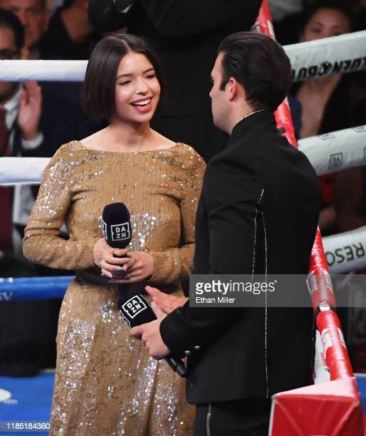 Singer Angela Aguilar talks with singer/actor Jencarlos Canela after Aguilar sang the Mexican national anthem and before Canela sang the American...