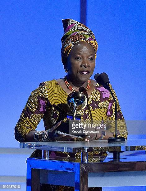 Singer Angelique Kidjo accepts the award for Best World Music Album for 'Sings' onstage during the GRAMMY PreTelecast at The 58th GRAMMY Awards at...