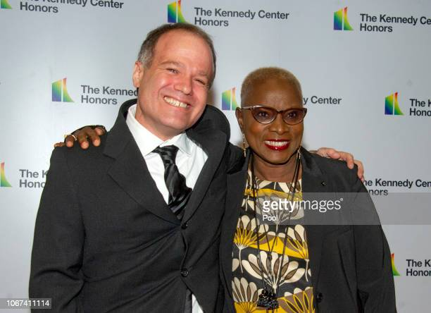 Singer Angelique Kidjo right and Kevin Morris arrive for the formal Artist's Dinner honoring the recipients of the 41st Annual Kennedy Center Honors...