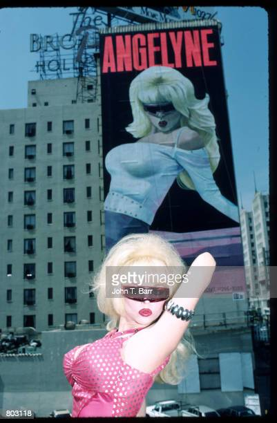 Singer Angelyne poses in front of her billboard July 1987 in Los Angeles CA Angelyne will release her new album'Beware of My Boyfriend' this month...