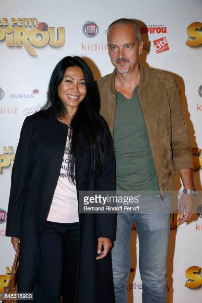 "Singer Anggun and Christian Kretschmar attend the ""Le Petit Spirou"" Paris Premiere at Le Grand Rex on September 10, 2017 in Paris, France."