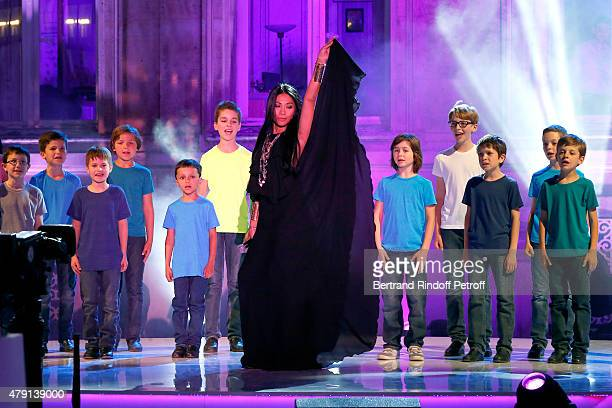 Singer Anggun performs during the 'Une Nuit avec la Police et la Gendarmerie' France 2 TV Show Held at Ministere de l'Interieur in Paris on June 30...