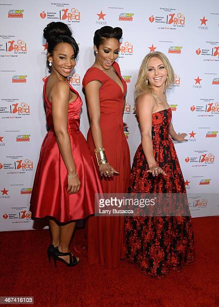 Singer Anika Noni Rose television personality Alicia Quarles and actress AnnaSophia Robb attend Go Red For Women The Heart Truth Red Dress Collection...