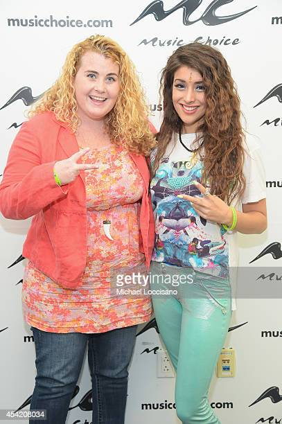 Singer Anjali and EditorinChief of Popstar magazine Colleen Broomall visit Music Choice on August 26 2014 in New York City