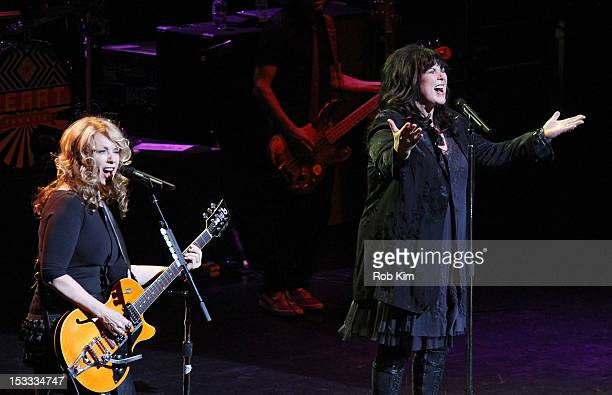 Singer Ann Wilson and Nancy Wilson of the rock band Heart perform at Beacon Theatre on October 3, 2012 in New York City.