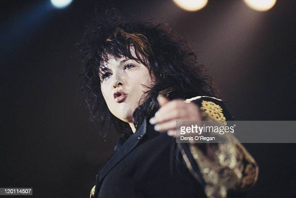 Singer Ann Wilson performing on stage with American rock group Heart circa 1985