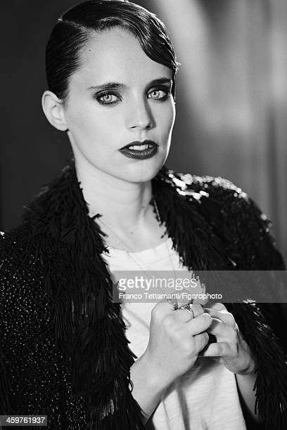 107955010 Singer Anna Calvi is photographed for Madame Figaro on September 26 2013 in Paris France Coat tshirt necklace rings personal CREDIT MUST...