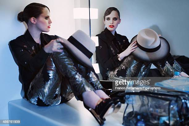 107955011 Singer Anna Calvi is photographed for Madame Figaro on September 26 2013 in Paris France Shirt pants necklace personal hat shoes clutch...