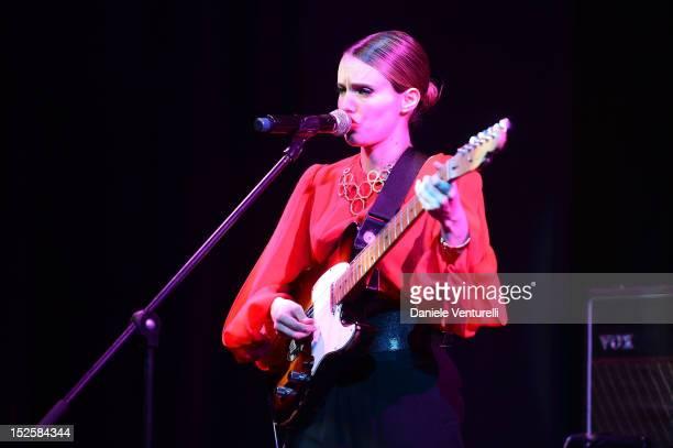 Singer Anna Calvi performs on stage at the amfAR Milano 2012 during Milan Fashion Week at La Permanente on September 22 2012 in Milan Italy