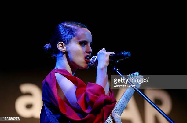Singer Anna Calvi performs on stage at the amfAR Milano 2012 during Milan Fashion Week at La Permanente on September 22 2012 in Milan Italy