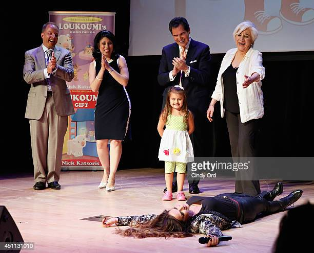 Singer Anna Vissi meteorologist Nick Gregory journalist Alexis Christoforous news anchor Ernie Anastos and actress Olympia Dukakis appear on stage...