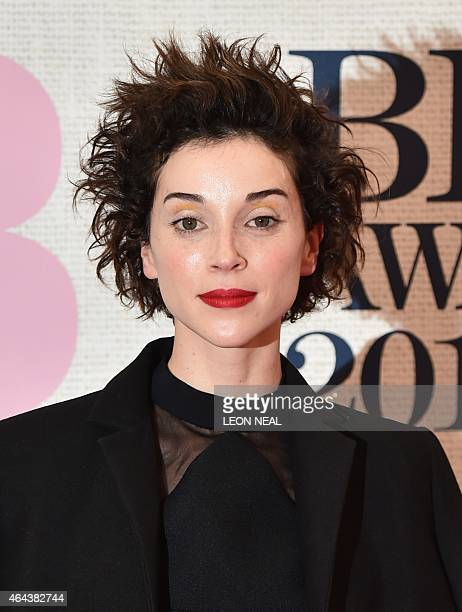 US singer Annie Clark also known as St Vincent poses on the red carpet to attend the BRIT Awards 2015 in London on February 25 2015 PERFORMER