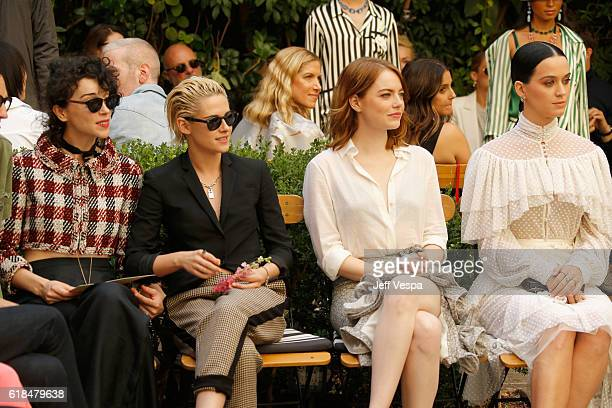 Singer Annie Clark of St Vincent actress Kristen Stewart actress Emma Stone and singer Katy Perry at the CFDA/Vogue Fashion Fund Show and Tea...
