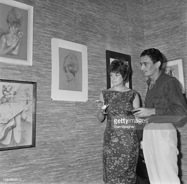 Singer Annie Ross and her husband actor Sean Lynch view a collection of portraits by recently deceased English osteopath and artist Stephen Ward at...