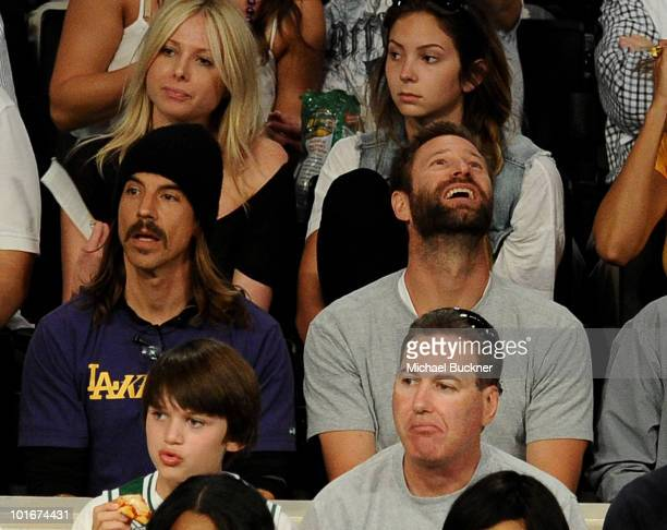 Singer Anthony Kiedis and actor Aaron Eckhart attend Game 2 of the NBA Finals between the Los Angeles Lakers and Boston Celtics at the Staples Center...