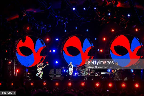 Singer Anthony Kiedis guitarist Hillel Slovak bassist Flea and drummer Jack Irons from Red Hot Chili Peppers performs at Roskilde Festival on June 29...