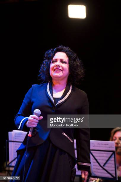 Singer Antonella Ruggiero performing with the Banda cittadina di Iseo at the Teatro Mucchetti in a original Christmas concert Adro Italy 11th...