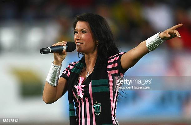 Singer 'Antonia aus Tirol' performes during the preseason friendly match between Wacker Innsbruck and Hamburger SV at the Tivoli stadium on July 7...