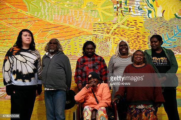 Singer Antony Hegarty poses with Aboriginal artists in front of the painting 'Kalyu', meaning water, at Sydney's Museum of Contemporary Art on June...