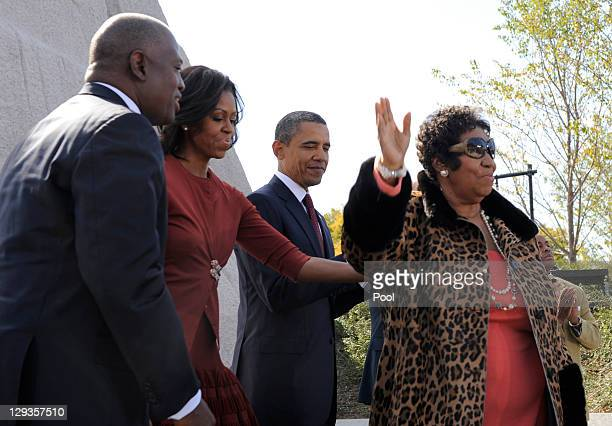 Singer Aretha Franklin accepts applause as she finishes her performance with US President Barack Obama first lady Michelle Obama and Harry Johnson...