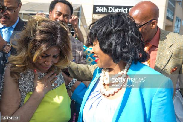 Singer Aretha Franklin becomes emotional during her street naming alongside Detroit City Councilwoman Brenda Jones on June 8 2017 in Detroit Michigan