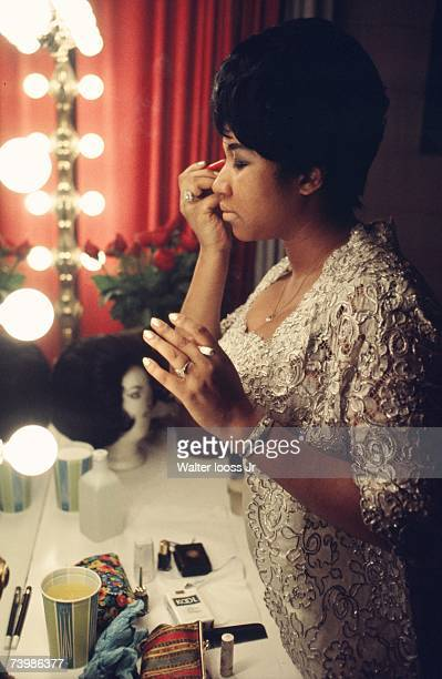 Singer Aretha Franklin fixes her makeup backstage before a performance at Symphony Hall in 1969 Newark New Jersey