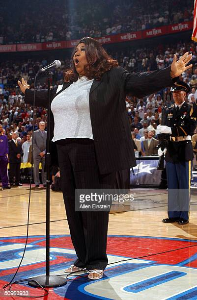 Singer Aretha Franklin gestures as she performs the national anthem before Game Five of the 2004 NBA Finals between the Detroit Pistons and the Los...