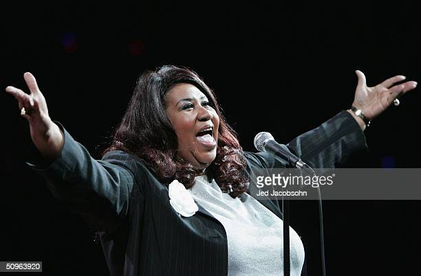 Singer Aretha Franklin performs the national anthem before the Detroit Pistons take on the Los Angeles Lakers in game five of the 2004 NBA Finals on...