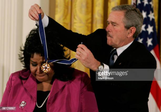 Singer Aretha Franklin recieves the Medal of Freedom from US President George W Bush during a ceremony at the White House November 9 2005 in...