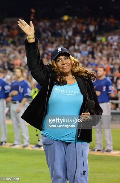 Singer Aretha Franklin waves to the crowd before performing the National Anthem before Game Three of the American League Championship Series between...