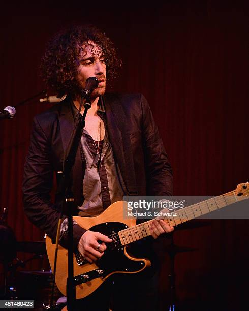 Singer Ari Herstand performs during his appearance at The Hotel Cafe on March 29 2014 in Hollywood California