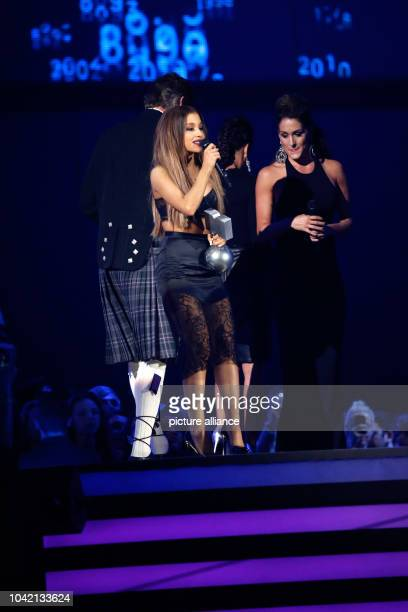 Singer Ariana Grande accepts an award during the 20th MTV EMA show in Glasgow UK on 09 November 2014 Photo Hubert Boesl NOWIRESERVICE | usage...