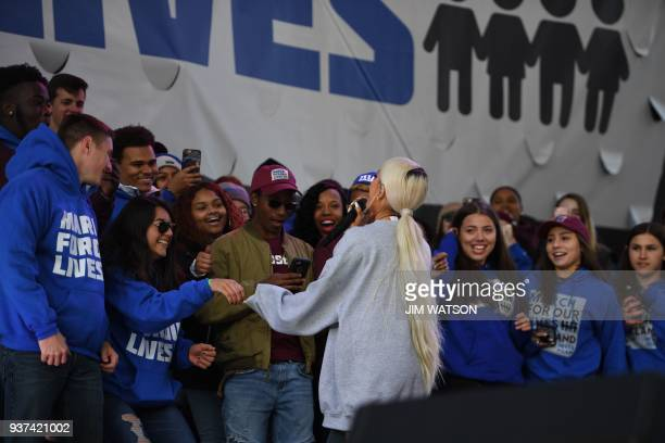 Singer Ariana Grande greets students after performing during the March for Our Lives Rally in Washington DC on March 24 2018 Galvanized by a massacre...