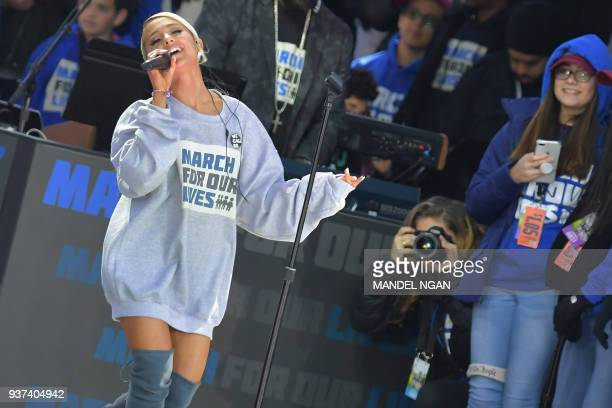 Singer Ariana Grande performs during the March for Our Lives Rally in Washington DC on March 24 2018 Galvanized by a massacre at a Florida high...